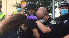 Police officer prays with protester in 'touching' photo