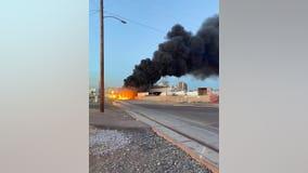 Firefighters battle train fire in Central Phoenix