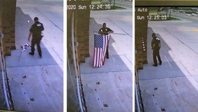 Nebraska officer seen fixing fallen US flag at auto-repair shop: 'The respect it deserves'