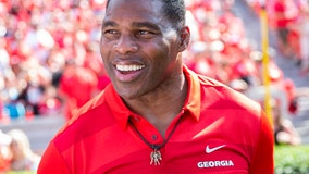 Herschel Walker offers to fly 'defund the police' supporters to countries without law enforcement