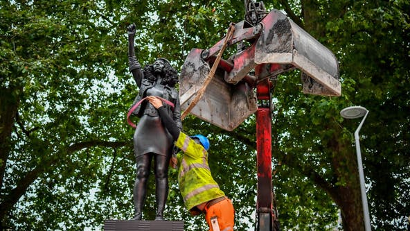 Black UK protester statue removed from pedestal in UK