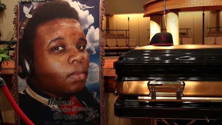 54df23e7-Funeral Held For Teen Shot To Death By Police In Ferguson, MO