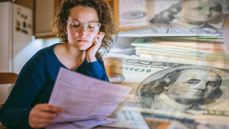 Credible-overwhelming-student-debt-pandemic-iStock-1141907951.jpg