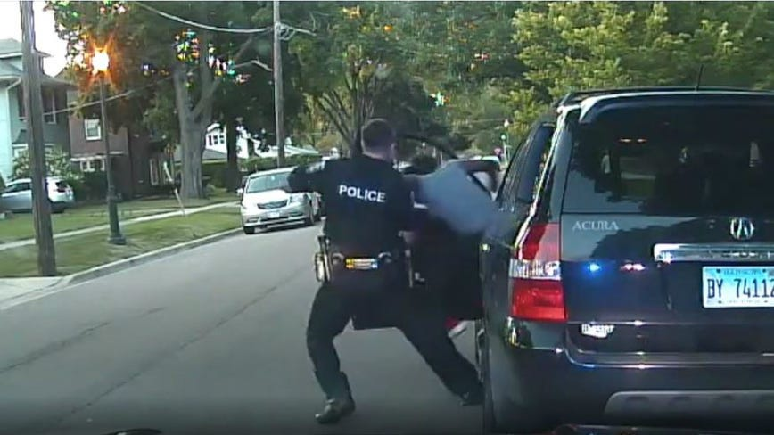 Aurora police release video of officer pulling woman from car in traffic stop
