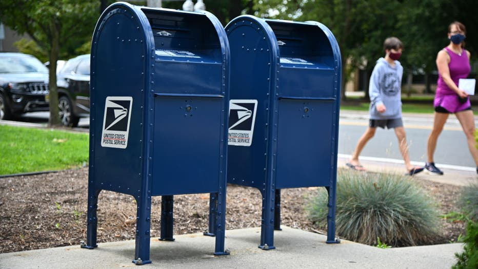 FILE - Mailboxes sit outside of a Morris Plains, NJ post office on August 17, 2020 in Morris Plains, New Jersey.
