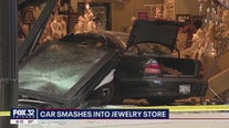Police chase ends with suspects' car smashing into Michigan Avenue jewelry store