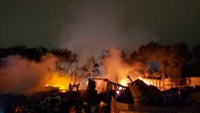 Crews battle 2-alarm fire at Austin scrap yard