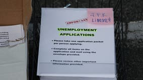 Layoffs remain elevated as 898,000 seek unemployment aid