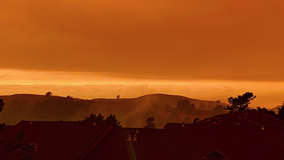 Wildfires cast eerie orange shade over Bay Area skies