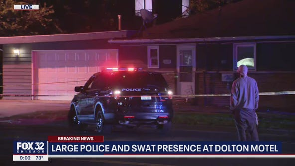 Woman, 4-year-old held hostage at south suburban motel, suspect now in custody