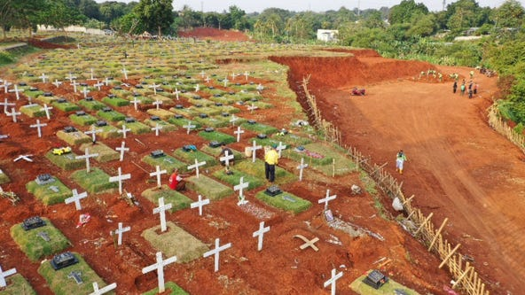 Indonesian official orders coronavirus victims' graves be dug by people busted without masks