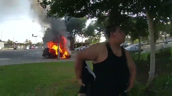 LAPD rescues wheelchair-bound man from vehicle moments before it bursts into flames in dramatic video