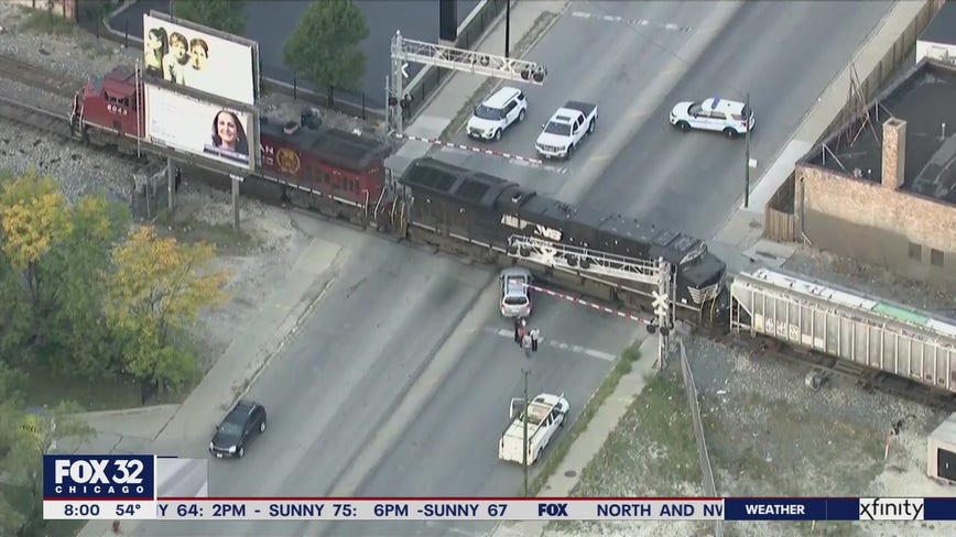 Police respond to vehicle hit by train in Archer Heights