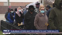 Suburban voters wait for hours to cast their ballots