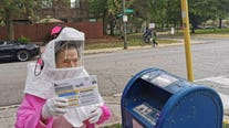 Retired Chicago teacher, 102, dons hazmat suit to vote by mail