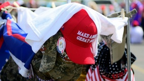 Man wearing pro-Trump baseball hat pulls out gun during confrontation with anti-Trump crowd