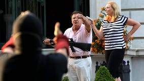 Gun-toting St. Louis couple suing news photographer