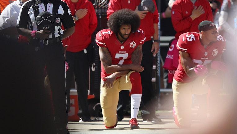 Colin Kaepernick kneeling