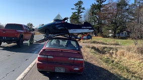 Wisconsin State Patrol stops vehicle with snowmobile on roof