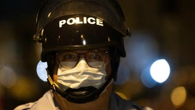 Should police be required to wear masks? Some cities say no