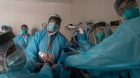 Overwhelmed hospitals scramble for help amid pandemic
