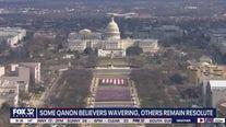 QAnon conspiracy theorists remain a force after Joe Biden's inauguration