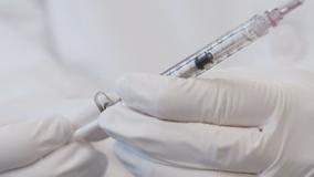 Pritzker diverts federal program vaccine to other priorities