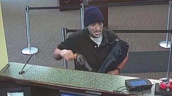 Paroled cop murderer gets life sentence for bank robbery
