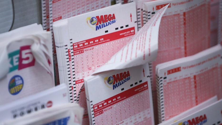 FILE - Mega Millions lottery tickets sit inside a convenience store in Lower Manhattan, Oct. 23, 2018 in New York City.