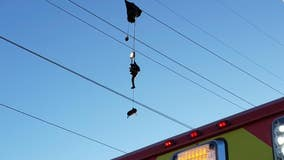 Parachutist dangles from power lines for hours before he can be safely rescued