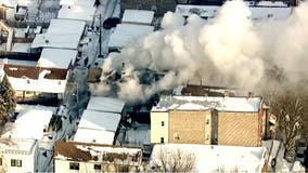 7 firefighters injured, 1 critically in extra-alarm Bridgeport fire: police