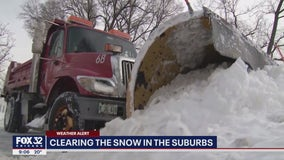 Some suburbs see over a foot of snow, crews continue to clear streets