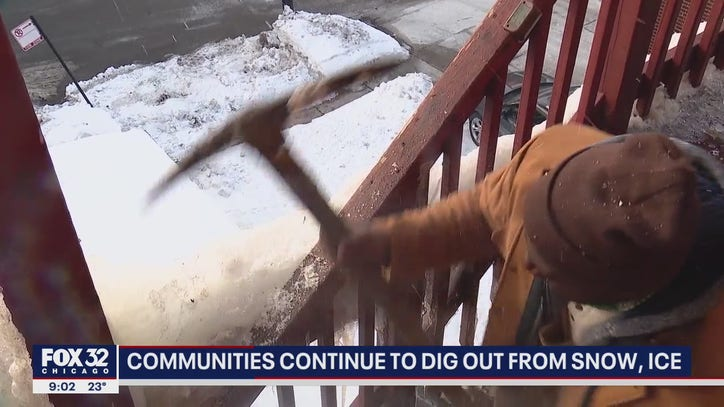 Chicagoans using pickaxes and hammers to get rid of thick ice and snow