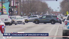 Chicago police officer suffers minor graze wound in shooting near police station