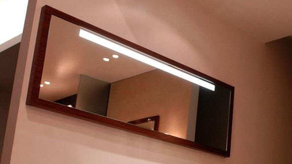 Woman removes bathroom mirror of NYC apartment, discovers hidden secret