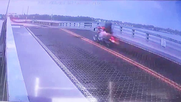 Video appears to show biker jumping over rising drawbridge in Daytona Beach