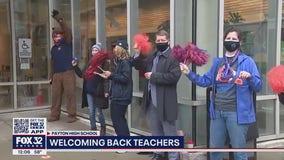Parents, guardians welcome back teachers at Walter Payton College Prep