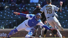 Pirates homer, relievers dominate to beat Cubs 5-3 on chilly Opening Day