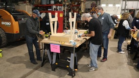 Suburban volunteers build desks for students learning remotely