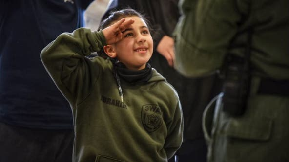 Chicago-area boy with life-threatening heart condition becomes SWAT officer for a day