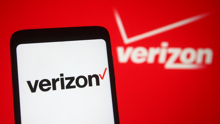 In this photo illustration, Verizon logo seen displayed on a