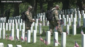 U.S. soldiers place flags at Arlington Cemetery ahead of Memorial Day weekend