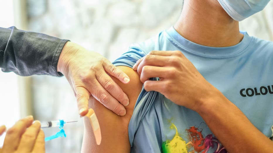 A young man receives his Covid-19 vaccination at a