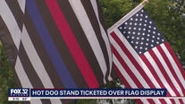 Illinois hot dog stand ticketed over American flag display