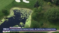 Child pulled from suburban pond, in critical condition