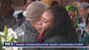 Chicago community holds vigil for Marine veteran who died in carjacking attempt