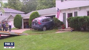 Evanston couple avoids tragedy after vehicle slams into their home