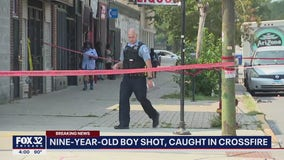 Boy, 9, shot near where father was killed in mass shooting four years ago