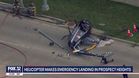 Helicopter crashes onto street near Chicago Executive Airport