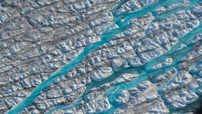 Rain falls atop Greenland's ice sheet for first time on record